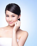 Beautiful Skin care woman Face. Smile to you isolated on blue background. asian Beauty Royalty Free Stock Photos