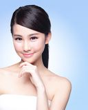 Beautiful Skin care woman Face. Smile to you isolated on blue background. asian Beauty Stock Image