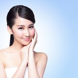 Beautiful Skin care woman Face. Smile to you isolated on blue background. asian Beauty Stock Images