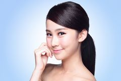 Beautiful Skin care woman Face. Smile to you isolated on blue background. asian Beauty Stock Photos