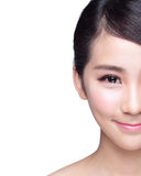 Beautiful Skin care woman Face. Smile to you isolated on blue background. asian Beauty Royalty Free Stock Images