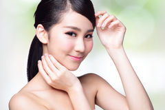 Beautiful Skin care woman Face. Smile to you with nature green background. asian Beauty Royalty Free Stock Photo