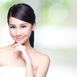 Beautiful Skin care woman Face. Smile to you with nature green background. asian Beauty Stock Images