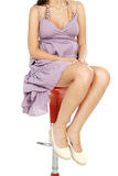 Beautiful skin women sitting on the bar chair with crossed legs. Royalty Free Stock Images