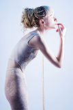 Beautiful skinny blonde fashion stands Royalty Free Stock Images