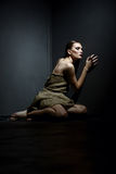 Beautiful skinny model in rags posing as prisoner Stock Images