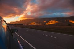 Beautiful sky above highlands from roadside stock photo
