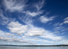A beautiful sky above the lake. Cirrus clouds and bottomless blue. Nature in summer. A beautiful sky above the lake. Cirrus clouds and a bottomless endless blue Royalty Free Stock Photography