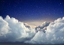 Beautiful starry night sky background with large clouds. Beautiful sky background with large clouds stock photo