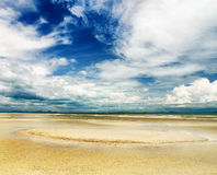 Beautiful sky and beach at low tide Royalty Free Stock Photography