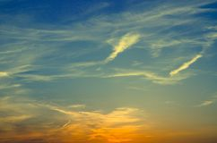 Beautiful sky. Blue, yellow color. Sun is setting. Background royalty free stock photography