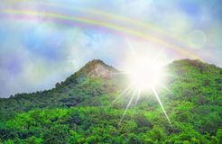 Beautiful sky cloud rainbow , green mountains dramatic light. Special effect Royalty Free Stock Photo