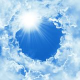 Beautiful sky with cloud and sunshine. Religion concept heavenly sky background. Divine shining heaven, light. Sunny day. Peaceful. Nature background stock photo