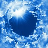Beautiful sky with cloud and sunshine. Religion concept heavenly sky background. Divine shining heaven, light. Sunny day, nature