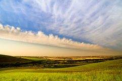 Beautiful sky with clouds in hilly countryside Stock Photos