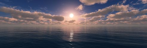 Beautiful sky with clouds and the sun over the sea. stock photo