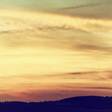 Beautiful sky with clouds at sunset. Filtered image royalty free stock photography