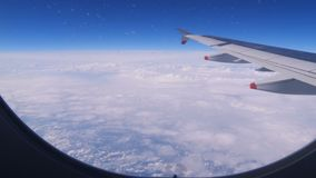 Beautiful sky and clouds view from the window of the plane stock footage