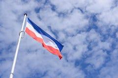 National Dutch Flag with blue cloudy sky Stock Photos