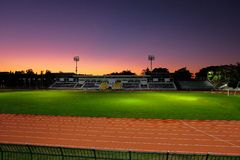 Beautiful sky light in sport stadium. And green field royalty free stock photo