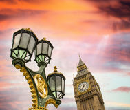 Beautiful sky over Big Ben and classic London lamp post Stock Photo