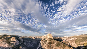 Beautiful sky over Half Dome mountain at sunset,. Royalty Free Stock Image