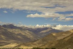 A beautiful sky over the valley of the Himalayan mountains stock image
