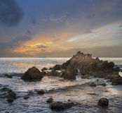 Beautiful sky, sea and rocks at sunset, Samae beach koh lan island Pattaya city Chonburi Thailand. Stock Photo