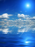 Beautiful sky with solar beams in reflection. royalty free stock photo