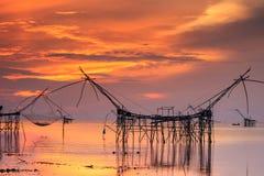 Beautiful sky and sunrise at Pak Pra village, Net fishing place Stock Photos