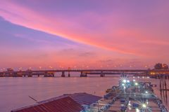 Beautiful sky during sunset going down to the sea above fish cage beside Sarasin