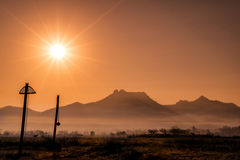 Beautiful sky sunset with orange light over nature colorful out. Door mountain ,travel in spring season ,landscape wallpaper ,warm tone ,selective focus royalty free stock image