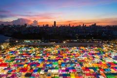 Beautiful sky after sunset over Bangkok flea market at night Stock Images