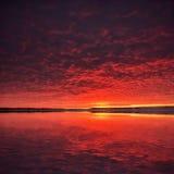 Beautiful sky sunset. Twilight dramatic red clouds Stock Photos