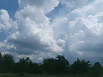 Beautiful sky with white clouds in Serbia. Royalty Free Stock Photo