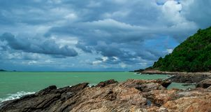 Beautiful skyclouds over the seabeach and big stone on beach at Khao Lam Ya, Rayong province Eastern of Thailand. Background, bay, beach, beautiful, big stock photo