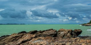 Beautiful skyclouds over the seabeach and big stone on beach at Khao Lam Ya, Rayong province Eastern of Thailand. Background, bay, beach, beautiful, big stock photography