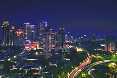 Beautiful skyscraper at night. Bird view of beautiful skyscraper and highway with light trails at night, shot in Jakarta, Indonesia Stock Photo