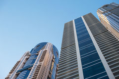 Beautiful skyscrapers on blue sky background Stock Photography