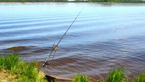 Beautiful slave quiet landscape on river. Secluded place with fishing rod.