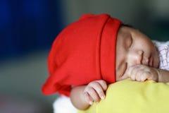 Beautiful Sleeping Baby. Baby asleep on adult shoulder Stock Photo