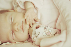 Beautiful sleeping baby girl. Close-up portrait of a beautiful sleeping baby girl. Cute infant kid. Child portrait in pastel tones Stock Photography