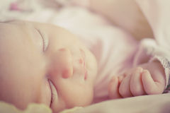 Beautiful sleeping baby girl. Close-up portrait of a beautiful sleeping baby girl. Cute infant kid. Child portrait in pastel tones Royalty Free Stock Photos