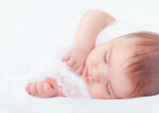 Beautiful sleeping baby girl on white. Two months old Stock Photography