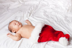 Beautiful Sleeping Baby in Santa's Hat Stock Image