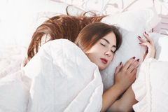Beautiful sleeping in bed girl portrait Royalty Free Stock Images