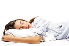Beautiful sleeping woman in pajamas Stock Images