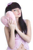 Beautiful sleeping woman in pink royalty free stock photography