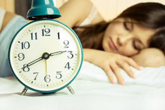 Beautiful Sleeping Woman With An Alarm Clock Stock Image