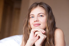 Beautiful sleepy young long haired woman waking up Royalty Free Stock Images